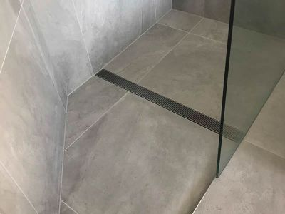 angled shower enclosure with full width drain