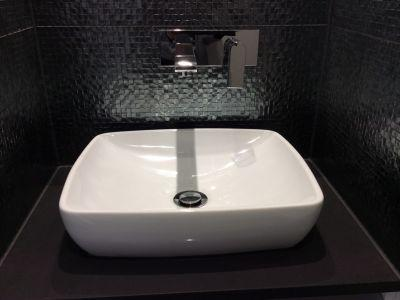 hand basin with dark feature tile sunshine coast