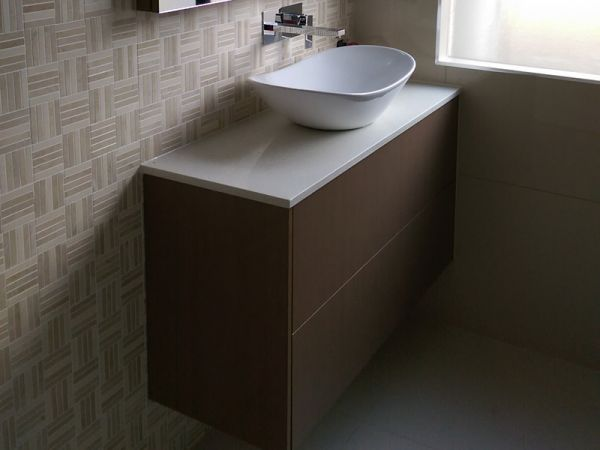 bathroom renovation vanity with surface mounted basin